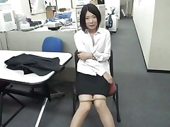 bored oriental girl sucks a sex tool at work