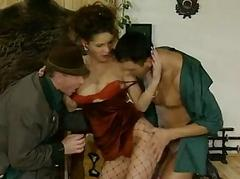 German Fishnet Brunette Plays With Two