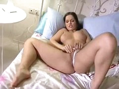 Hot masturbating Euro girl in bed