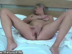 Blond mature lady loves playing